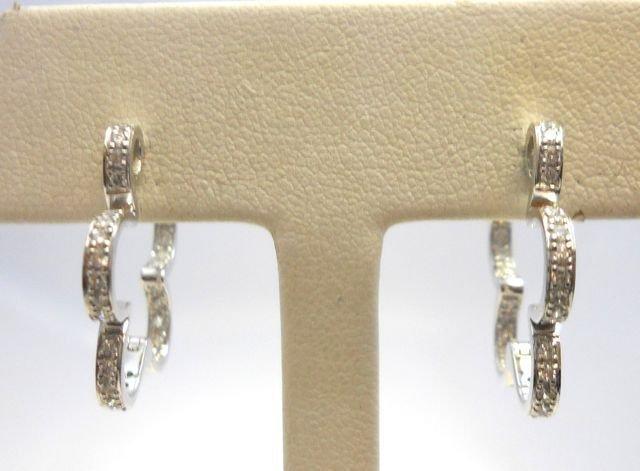 5: Pair (2) of 18K White Gold Flower Shaped Earrings.