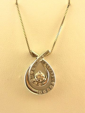 10: 14K White Gold necklace with a round diamond,