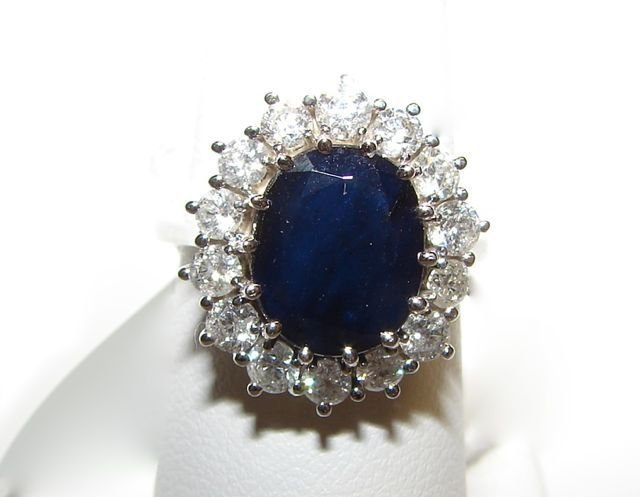 57: Ladies 14K White Gold Diamond Sapphire Ring.