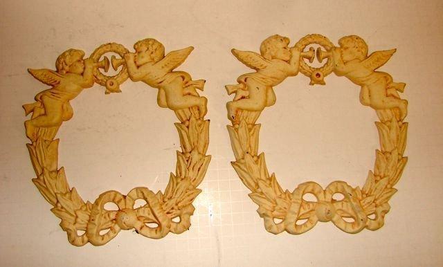 Pair (2) of Cast Iron Putti Wreaths Garniture.
