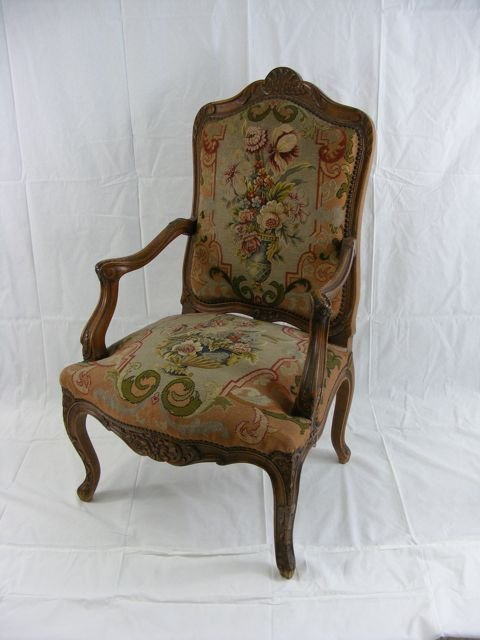 French Provincial Carved Needlepoint Arm Chair.