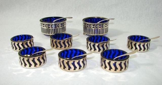 Group of Nine (9) Sterling Open Salts. w/Spoons.