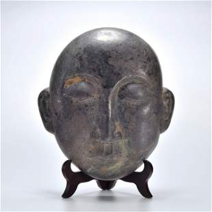 A Silver Figural Mask