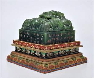 An Inscribed Spinach Green Jade Dragon Seal