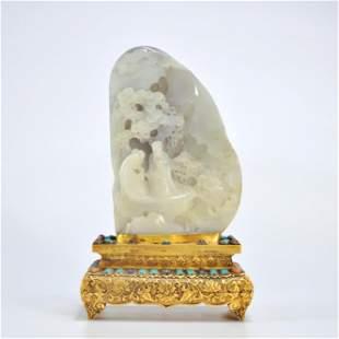 A Carved Jade Boulder Buddha