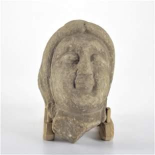 A Carved Stone Figure Head