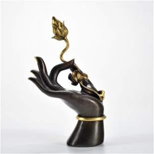 A Bronze Parcel Gilt Buddha Hand