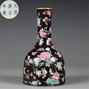 A Black Ground Famille Rose Bell Shaped Vase Qing