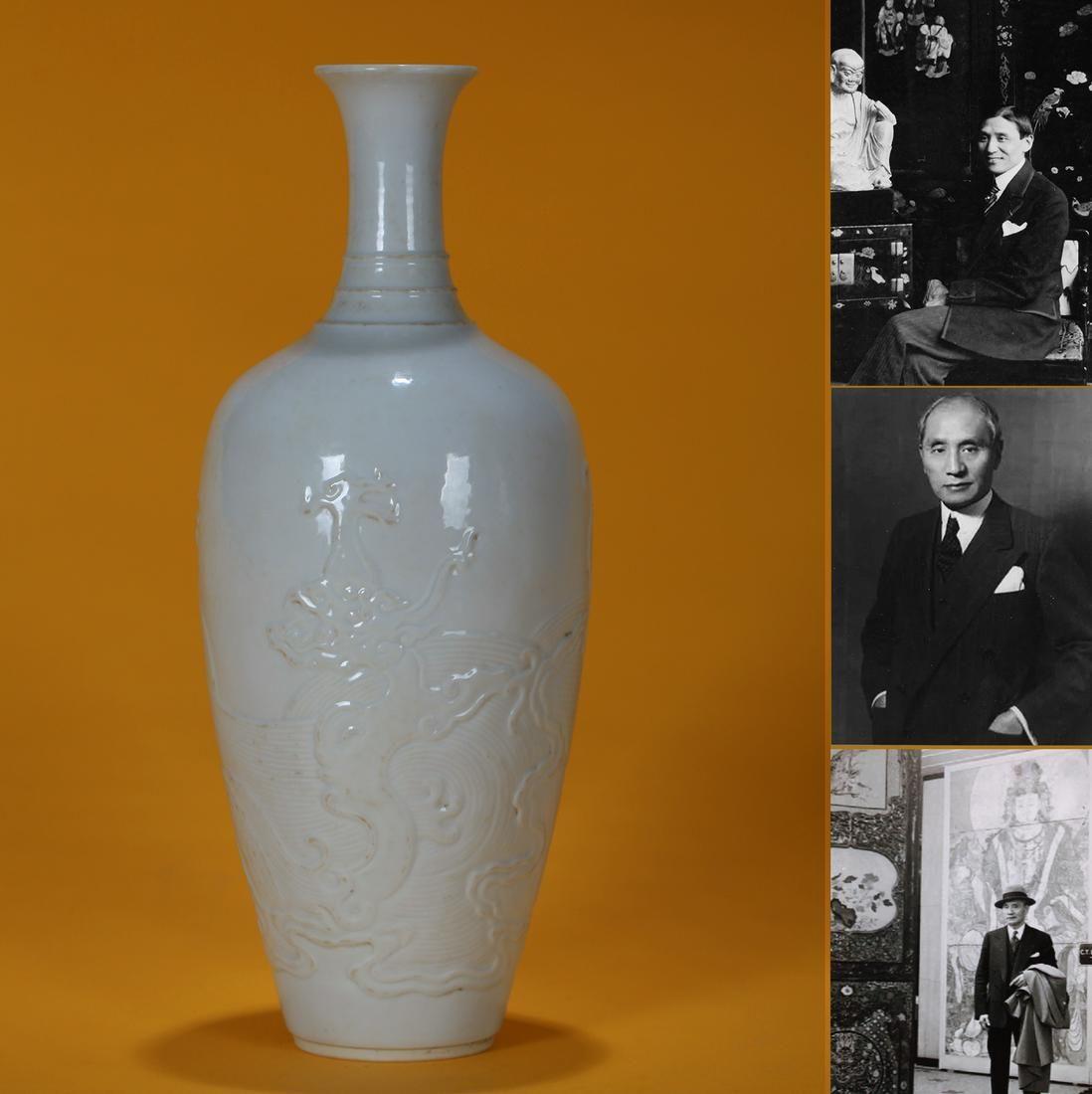A White Glazed Dragon and Waves Vase Ming Dynasty