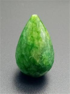 A large (115.4 carats), pear shaped and drilled emerald