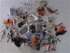 lot of star wars action figures and pieces