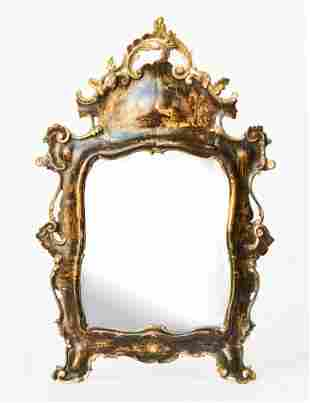A Rococo Parcel-Gilt and Brown Painted Venetian Mirror,