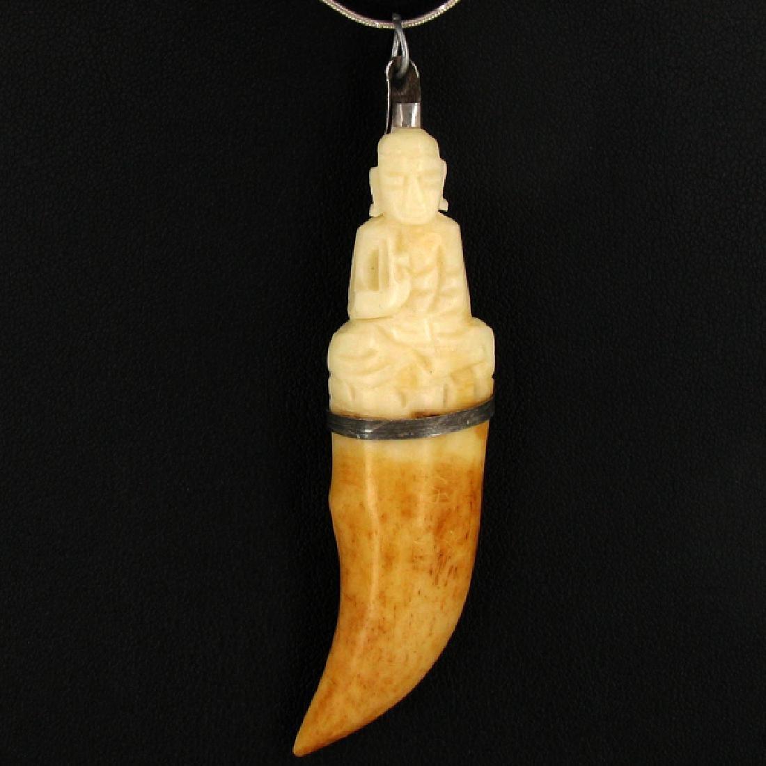 58.62ct Carved Bone Buddha Pendant
