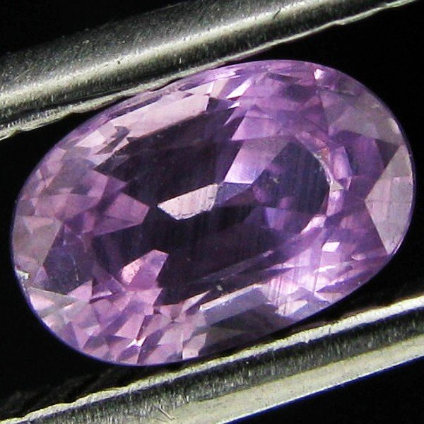 11: 0.67ct Fancy Color Sapphire Oval EST: $15 - $30 (GE