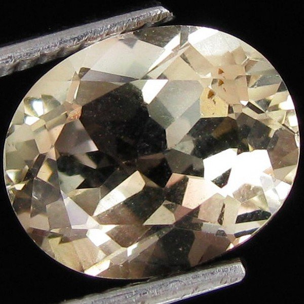 80: 2.10ct Clear Champagne Oregon Sunstone Oval EST: $4