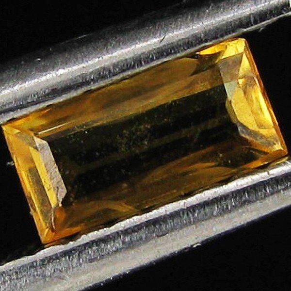 1280: 0.25ct Orange Yellow Songea Sapphire Baguette