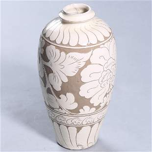 An incised white-glazed floral pottery vase