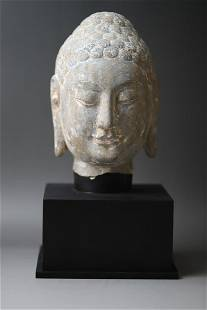 A Buddha Head Sone Figure Statue