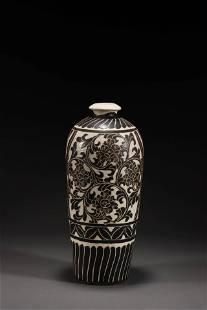A Cizhou Kiln Carved Flower Pattern Porcelain Vase