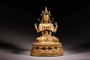 A Gilt Bronze Four Arms Guanyin Figure Statue