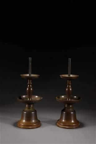 A Pair of Bronze Candlestick