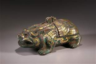 A Chinese Bronze Inlaid Gold and Silver Beast Figure