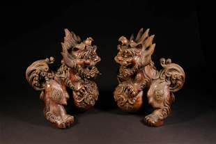 A Pair of Playing Wood Lions Figure