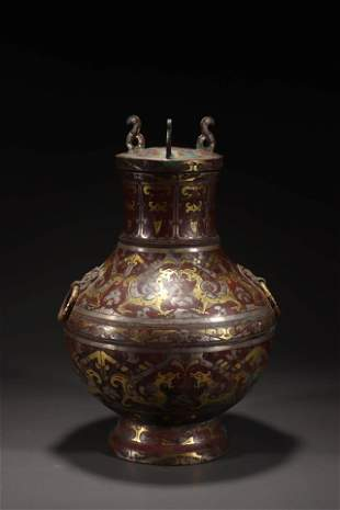 A Chinese Bronze Gold and Silver Inlaid Base