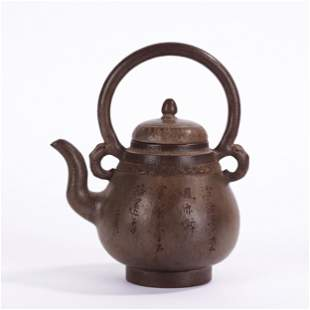 A CHINESE INSCRIBED YIXING GLAZED TEA POT