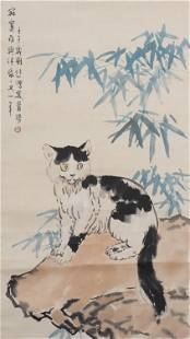 A CHINESE PAINTING OF CAT ON ROCK