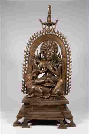A Sino-Tibetan bronze figure of Vaisravana in a shrine