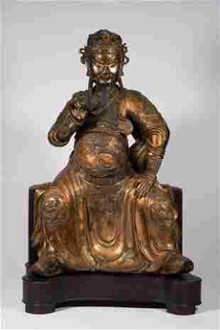 A Chinese gilt bronze figure of seated Guandi