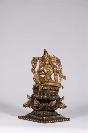 A Chinese imperial gilt bronze figure of Green Tara
