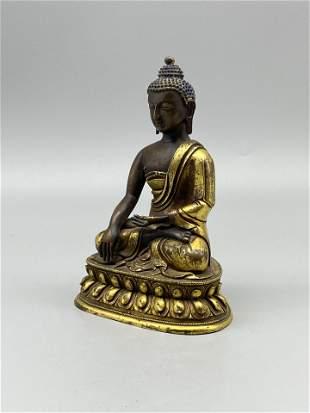 A Sino-Tibetan gilt-bronze figure of Shakyamuni Buddha