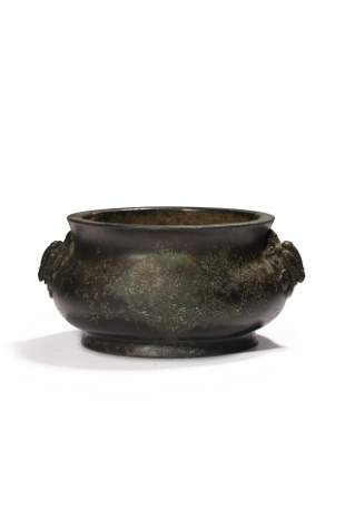 A bronze censer, paired with two lion-head handles,