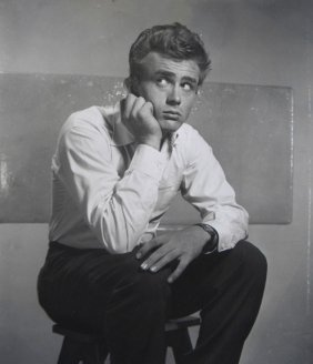 21: James Dean sitting on stool photograph, 8 x 10