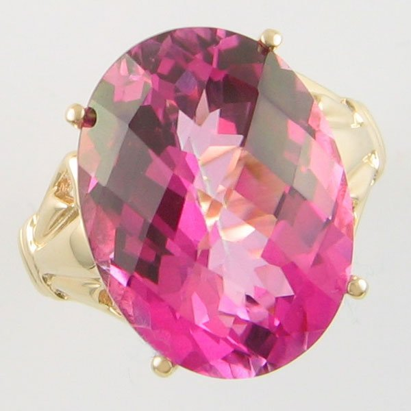 1017: 10KT PINK TOPAZ OVAL GOLD RING SIZE 7 12.0TCW