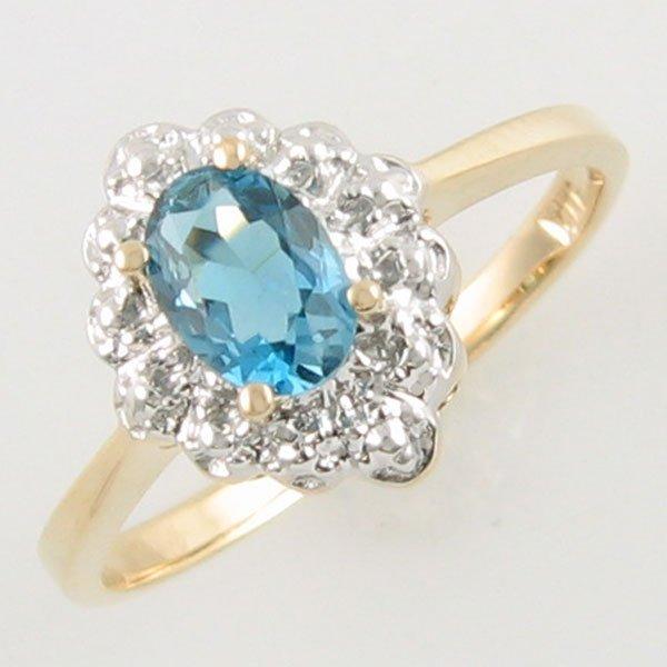 2003: 14KT BLUE TOPAZ GOLD RING 0.38 TCW SIZE 6.75