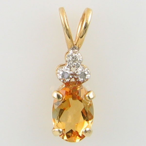 4023: 14KT CITRINE DIAMOND GOLD PENDANT 0.59TCW