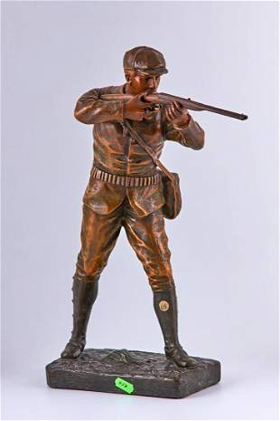 Patinated spelter statuette of a hunter by Henri Fugere