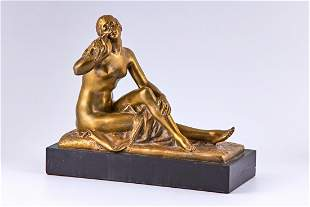 An early 20th century gold plated bronze sculpture of