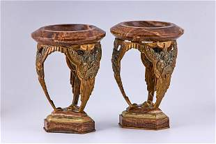 A pair of Art Deco bronze and marble decorative vases