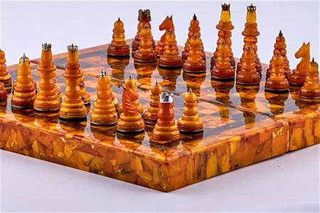 Baltic amber chess set with silver decorative elements