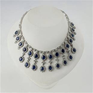 18K WHITE GOLD DROP NECKLACE SET WITH Sapphires.