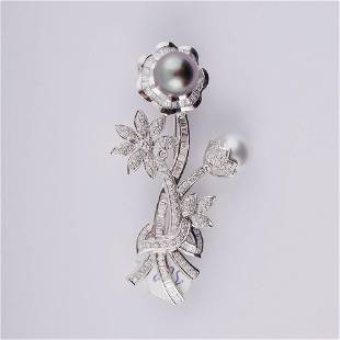 18K WHITE GOLD BROOCH SET WITH Pearls.