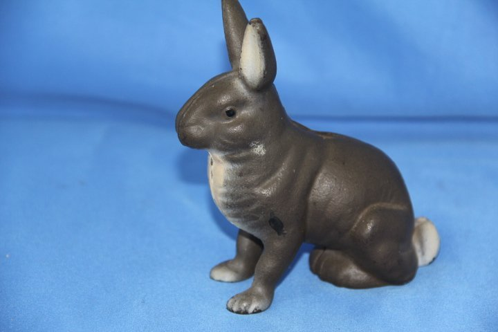 Cast Iron Rabbit Bank with Painted Feet.  Circa 1940