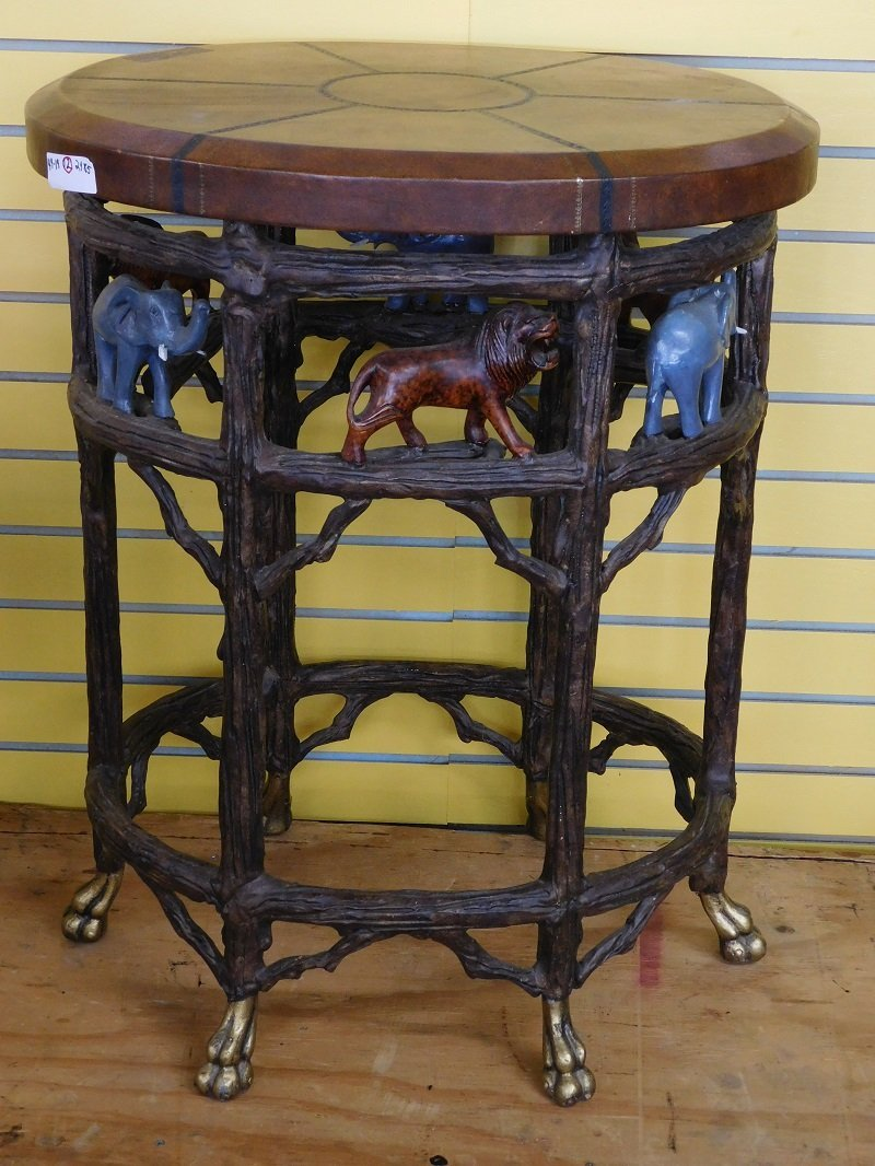 Oval Leather Top Table with Ornate Wildlife Base
