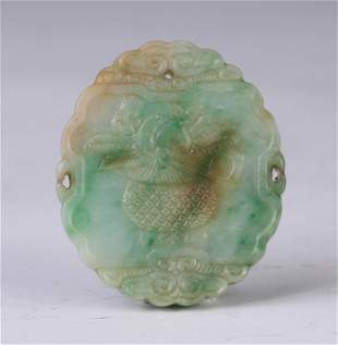 A Carved Jadeite Fruit Basket Pendant