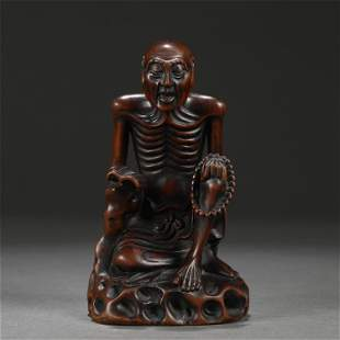 A Carved Chengxiang Wood Seated Figure