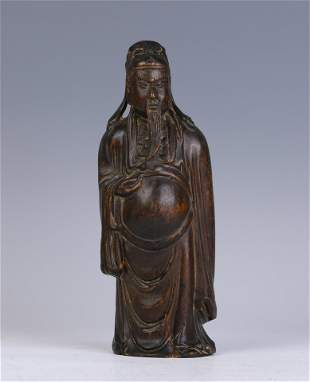 A Wood Carving of Standing Figure
